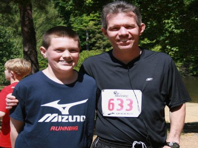 Fifth-grader leads Dad to love of running, better health